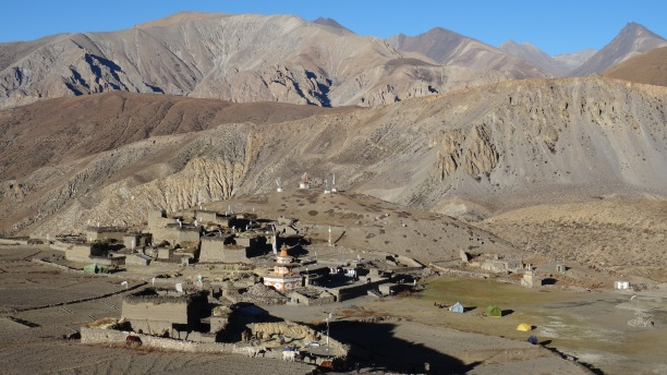 View of Koma Gaon village, with our camp on the central grass field in front of the school.