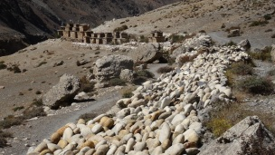 Beautiful Mani Walls made out of polished round river rocks along the trail.
